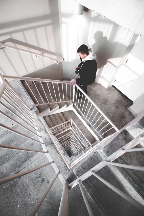 Man Walking on Spiral Stairs