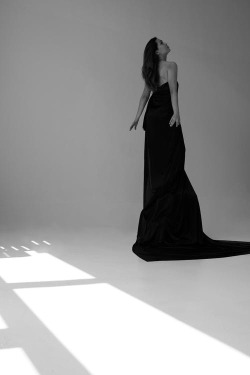 Grayscale Photography of Woman Wearing Long Train Gown