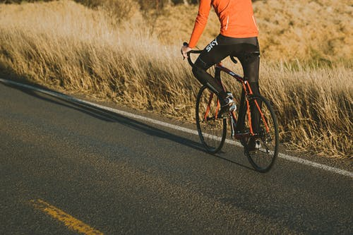 Photo of Person Riding Road Bike