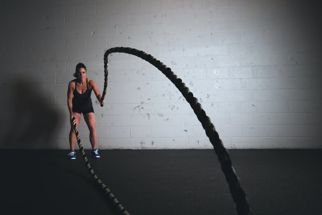 Woman Holding Exercise Ropes
