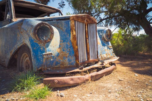 Photo Of Abandoned Blue Vehicle