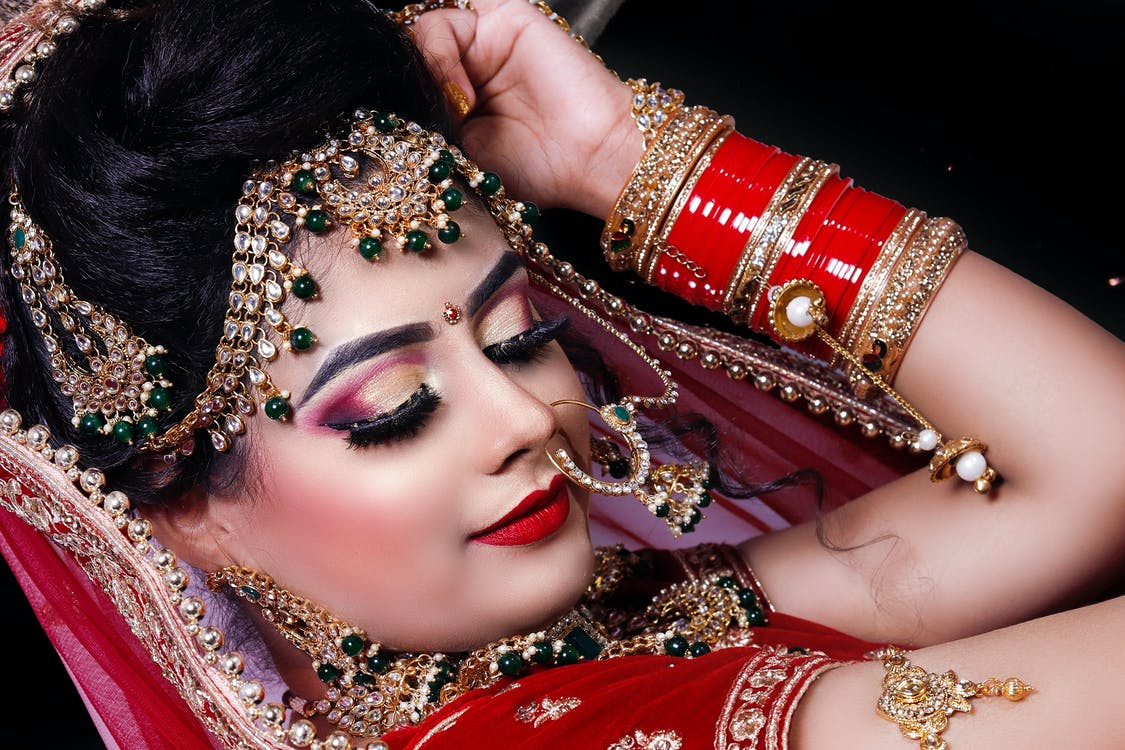 Woman In Red and Gold Jewelries
