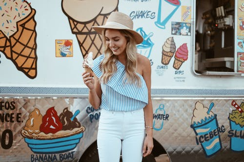 Photo Of Woman Holding Ice Cream Cone
