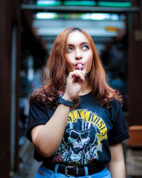 Photo Of Woman Eating Lollipop