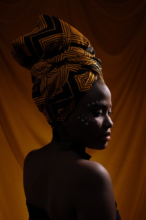 Photo of Woman in African Headscarf Posing
