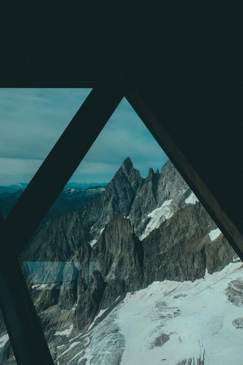View of Mountain Alps from a Window