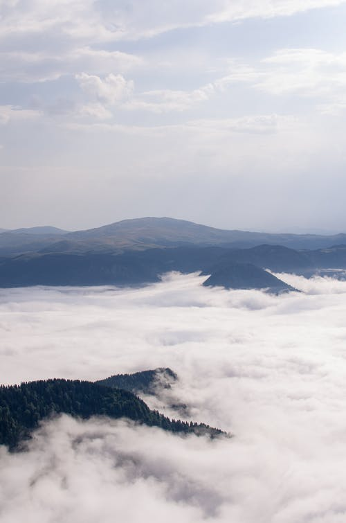 Photo Of Mountains Covered With Clouds