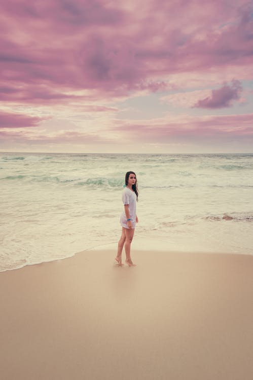 Photo Of Woman Standing In The Shore