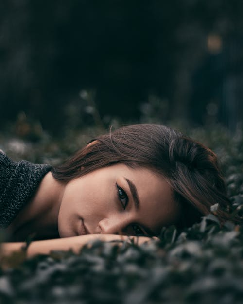 Woman Lying Down on Ground