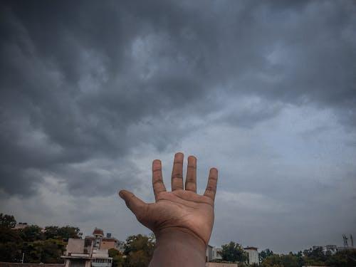Free stock photo of clouds, dark moody, hand, moody