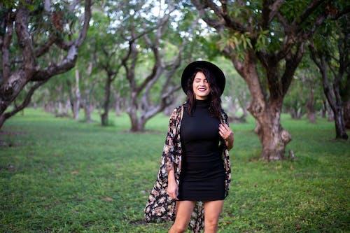 Smiling Woman Wearing Black Dres