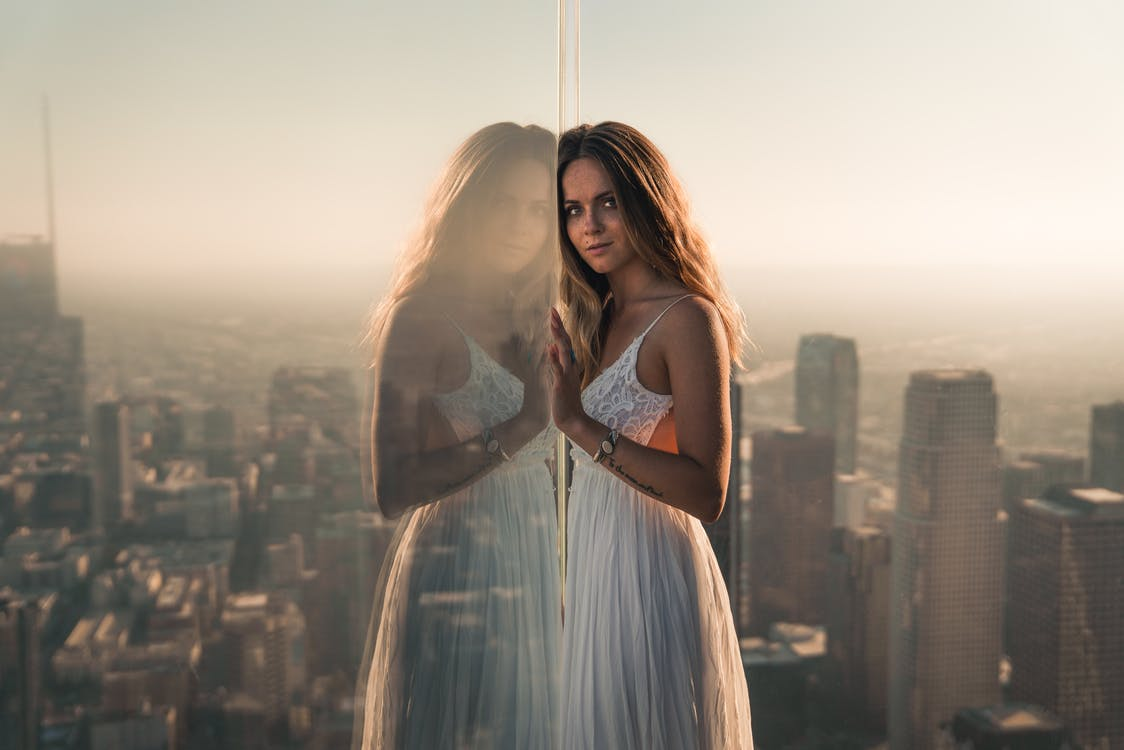 Photo Of Woman Leaning On Glass