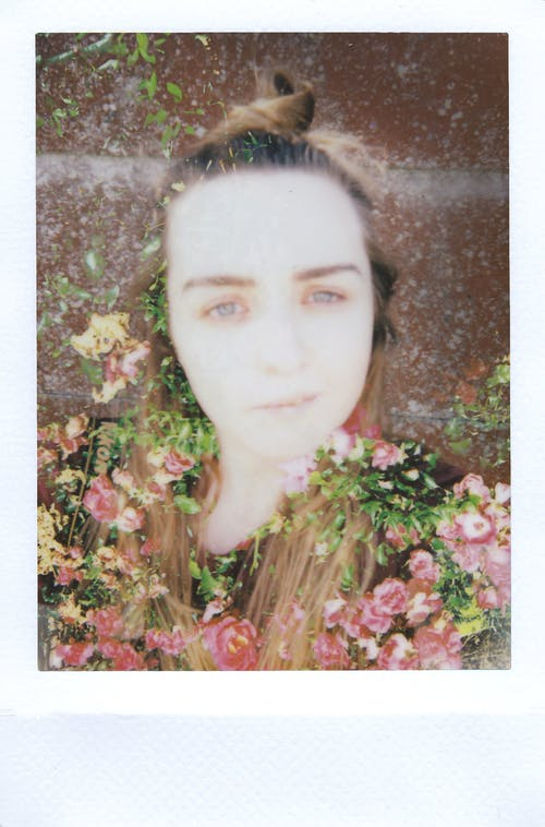 Photo Of Woman's Face Surrounded By Flowers