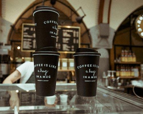 Бесплатное стоковое фото с кофе, кофейные чашки, кофейня, одноразовая чашка