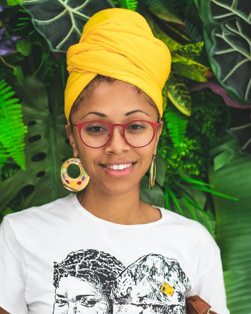 Portrait Photo of Smiling Woman in Yellow Headscarf and White T-shirt Posing