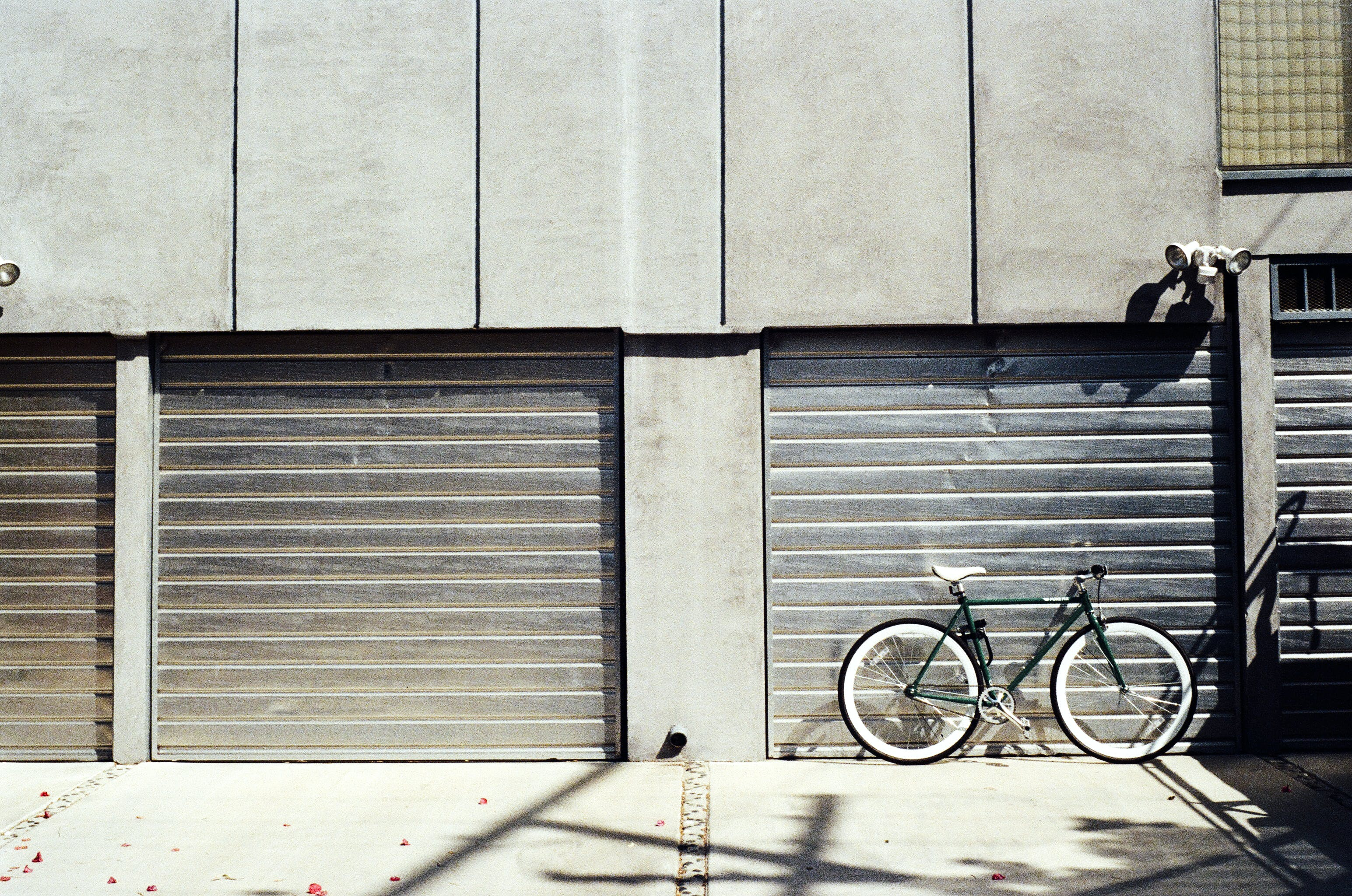 Green Bike Near Roll-up Door