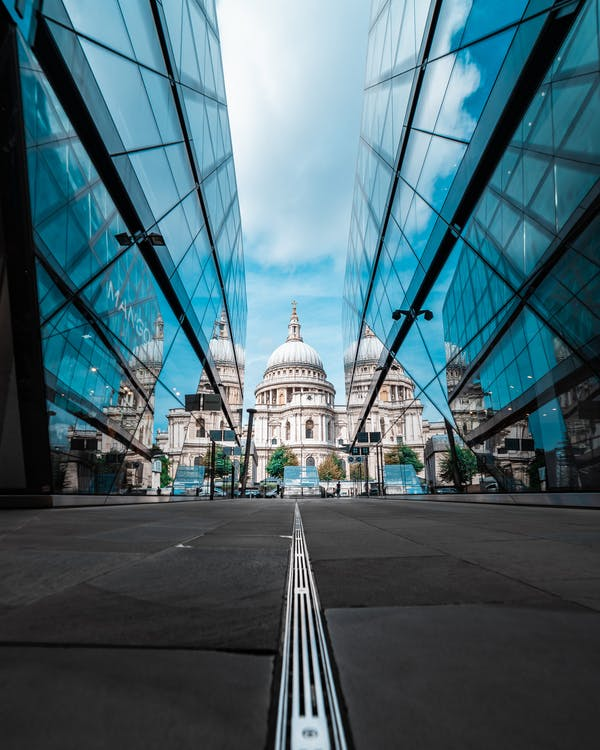 Low Angle Shot of St. Paul's Cathedral Between Glass Buildings