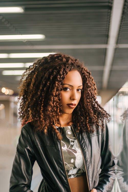 Woman Wearing Black Zip-up Leather Jacket