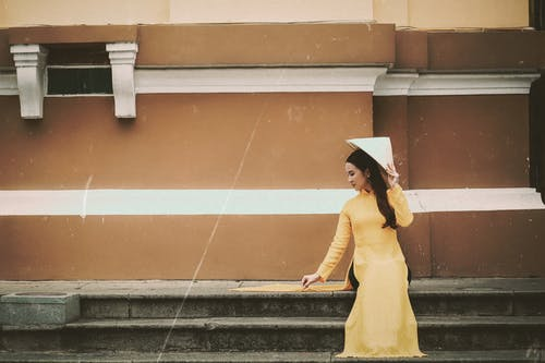 Woman in Yellow Long-sleeved Traditional Wear