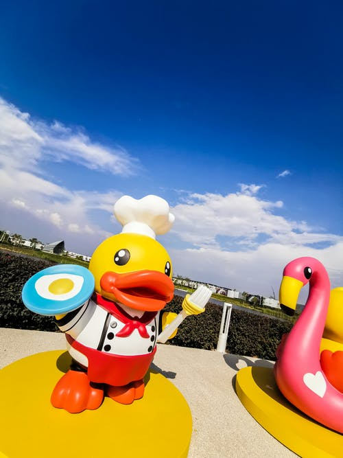 Free stock photo of duck, event, moscow, pink