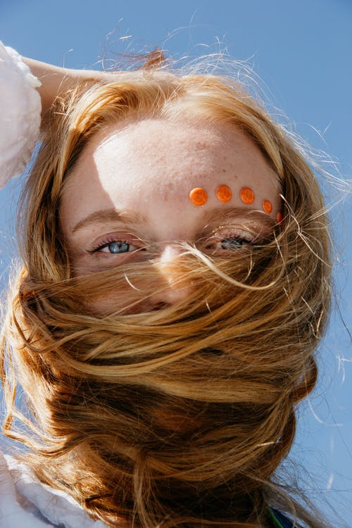 Photo of Woman's Face Wrapped in Her Own Hair