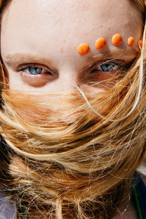 Close-up Photography of Woman Covering Her Face With Her Hair