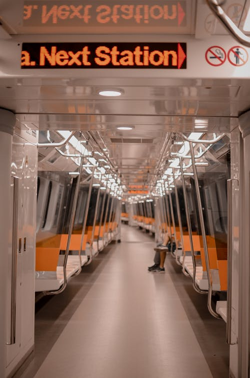 White And Orange Train Seats