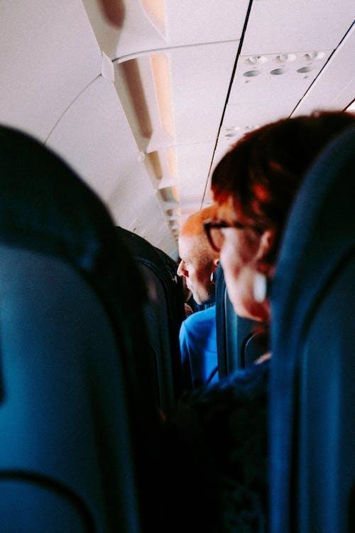 人, 女人, 客機, 旅行 的 免费素材照片