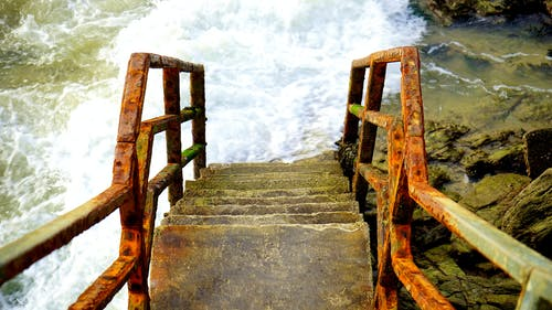 High-angle Photography of Staircase Leading to Seashore