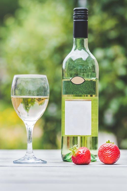 Wine Glass and Liquor Bottle
