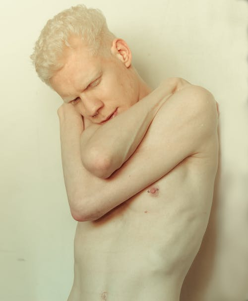 White-haired Topless Man Holding Shoulders Photo