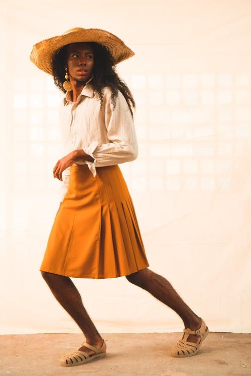 Woman Wearing Yellow Skirt and White Long-sleeved Top Photo