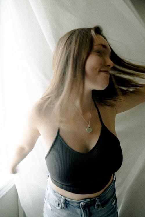 Woman Wearing Black Spaghetti-strap Crop-top