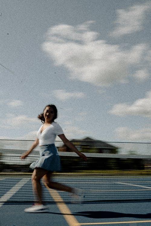 Running Woman on Tennis Field