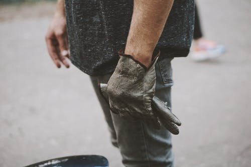 Person Wearing A Glove