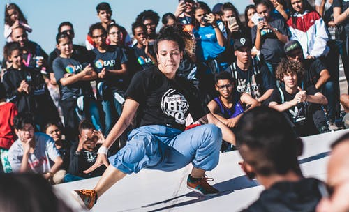 People Watching A Woman Dancing Hip Hop