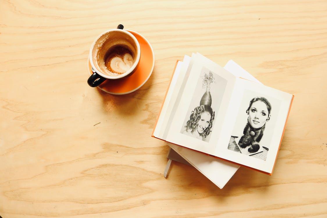Ceramic Cup Besides Photo Album