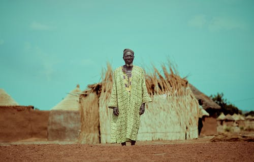 Elderly Man Standing Near Structure