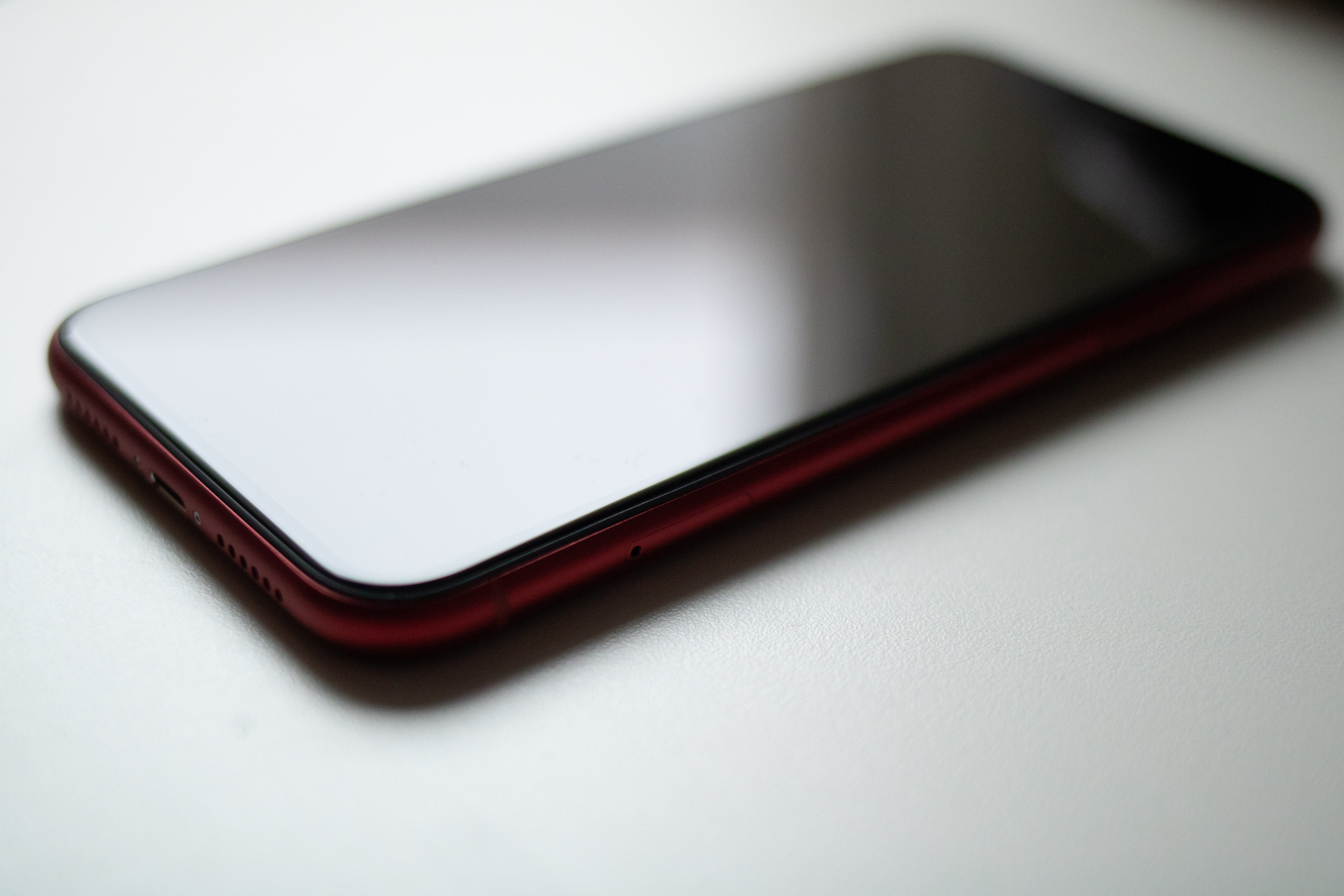 Red Smartphone on White Surface