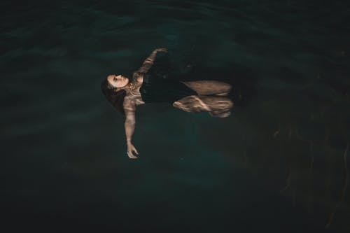 Woman Floating on Water