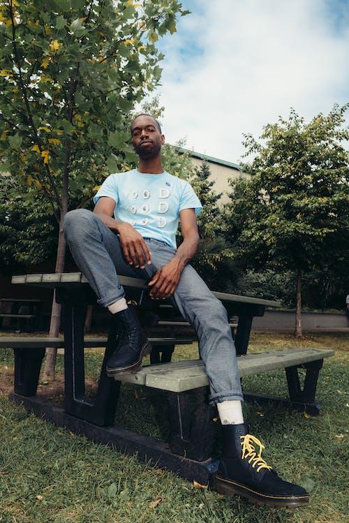 Man Wearing Blue Crew-neck T-shirt