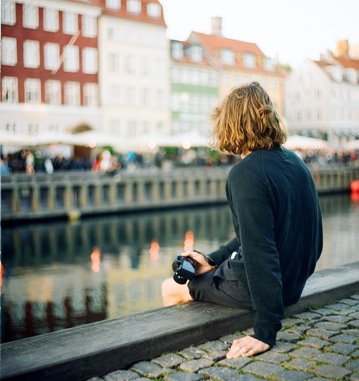 Person Siting Near River
