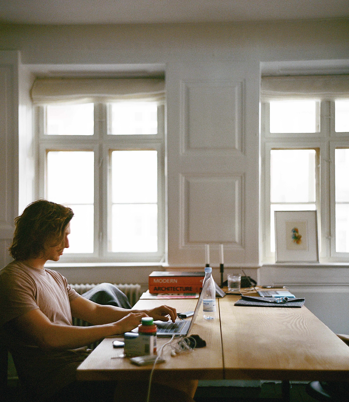 Man Sitting While Using Laptop