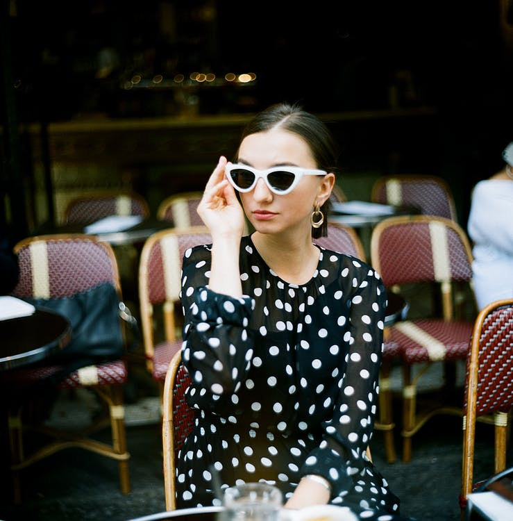 Woman Wearing Polka-Dots Long-Sleeved Top