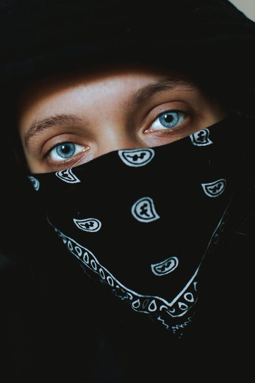 Photo Of Woman In Black Bandana
