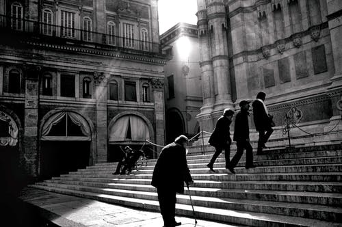 People Walking on the Stairs Grayscale Photo