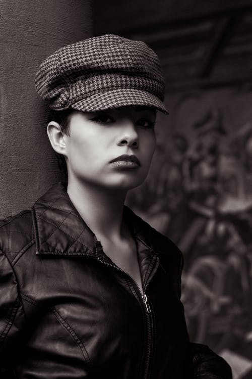 Grayscale Photography of Woman Wearing Black Zip-up Jacket
