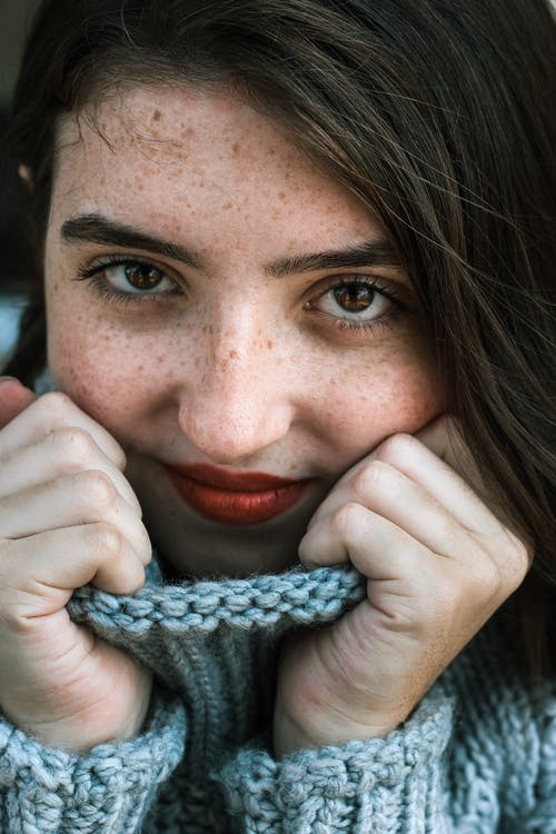 Close-Up Photography Of Woman In Knitted Sweater