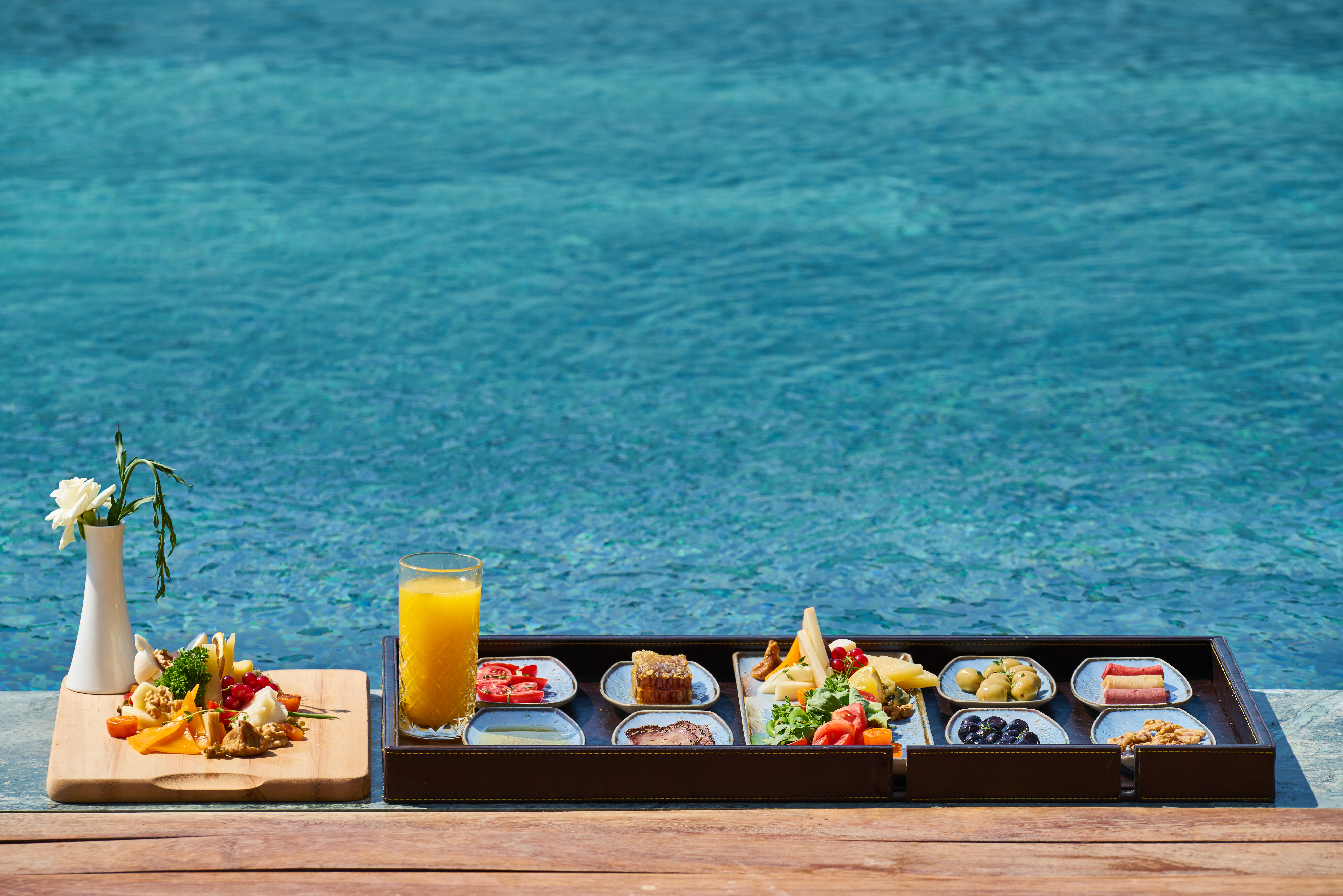 Tray of Food Beside Body of Water
