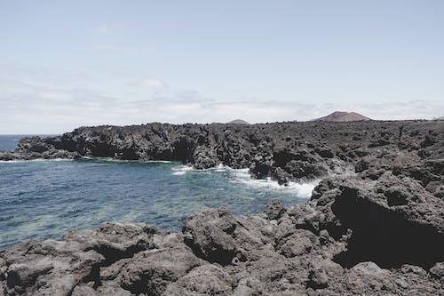 海, 溶岩の無料の写真素材